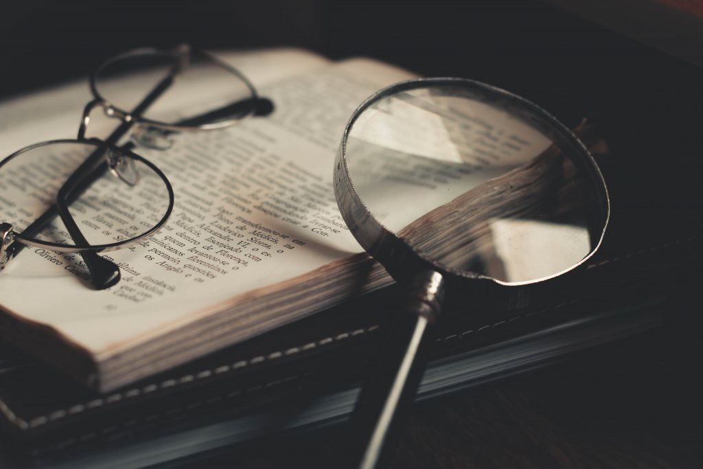Glasses and magnifying glass on a book